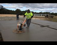 Finishing slab with concrete helicopter